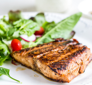 Grilled salmon and a salad on a plate